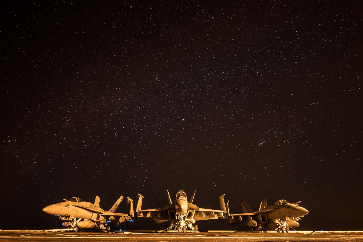Three F/A-18 Hornets rest on the flight deck of the aircraft carrier USS Theodore Roosevelt (CVN 71) in the Arabian Gulf on Dec. 22, 2017. Theodore Roosevelt and its carrier strike group are deployed to the U.S. 5th Fleet area of operations in support of maritime security operations to reassure allies and partners and preserve the freedom of navigation and the free flow of commerce in the region.