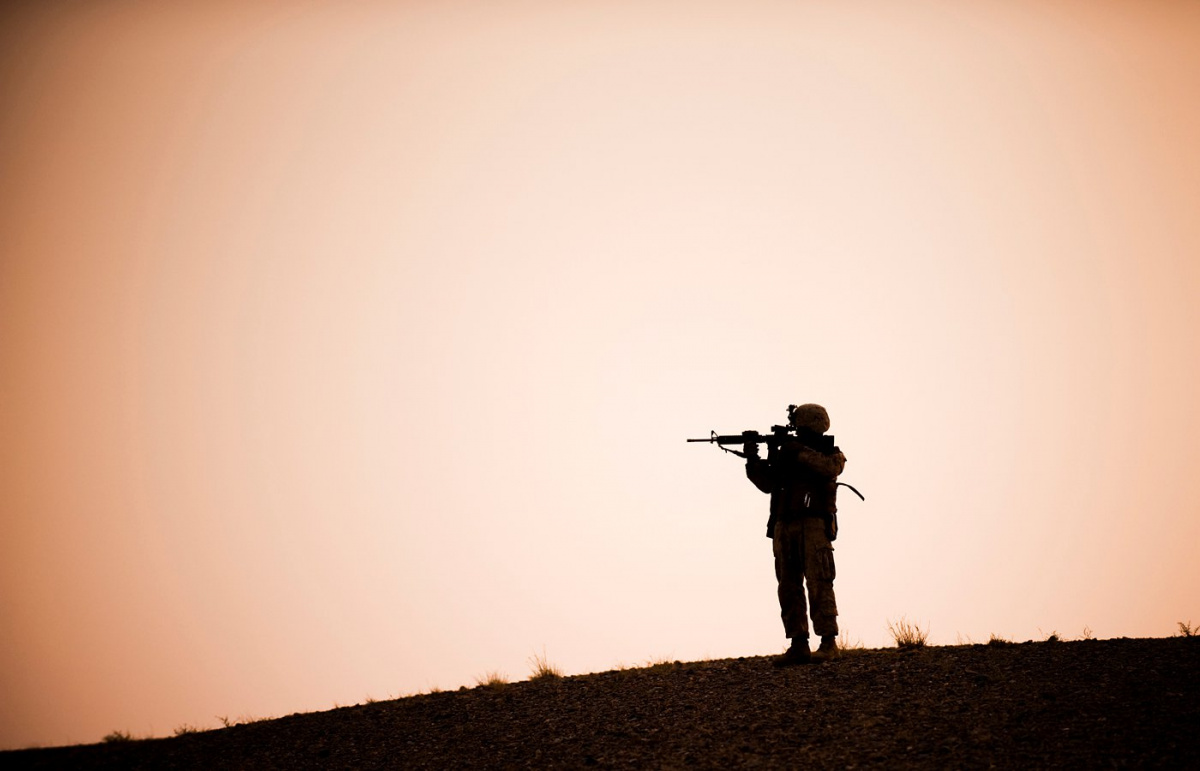 A Marine with Lima Company, 3rd Battalion, 3rd Marine Regiment scans the horizon at the start of a nine-hour night patrol in the Helmand province of Afghanistan. Flickr / U.S. Central Command