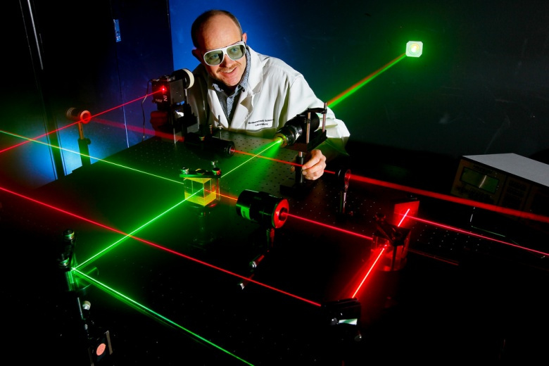 """Image: """"NORCO, Calif. (May 19, 2011) Daniel King, Microwave/Electro-Optic (MS32) electronics engineer at Naval Surface Warfare Center (NSWC), Corona Division, prepares alignment of various optical components using eye-safe visible lasers. Under the Navy Metrology Research and Development Program, NSWC Corona's E-O Group has developed and patented two calibration standards for support of laser designator and rangefinder test sets. The laser transmitter supports standards keeps ordnance on target and reduces"""