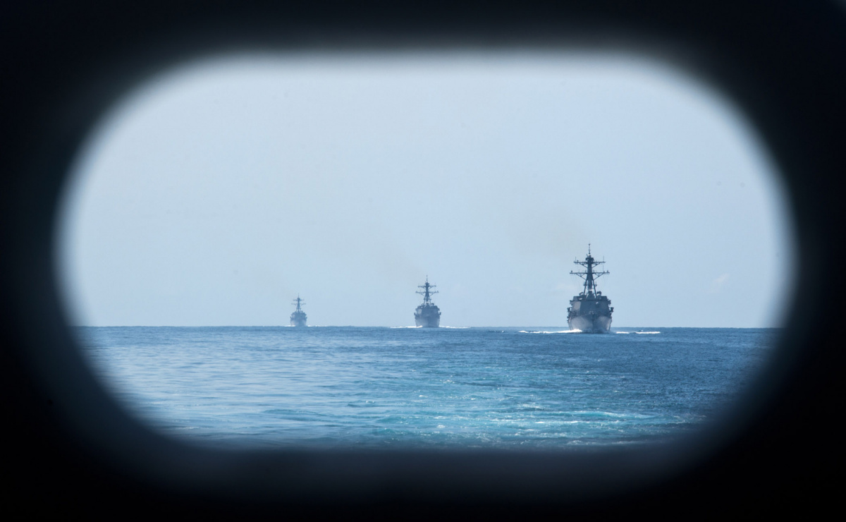 The Arleigh Burke-class guided missile destroyers USS Kidd (DDG 100), USS Pinckney (DDG 93), and USS Dewey (DDG 105) steam the South China sea behind the Nimitz-class aircraft carrier USS John C. Stennis (CVN 74)