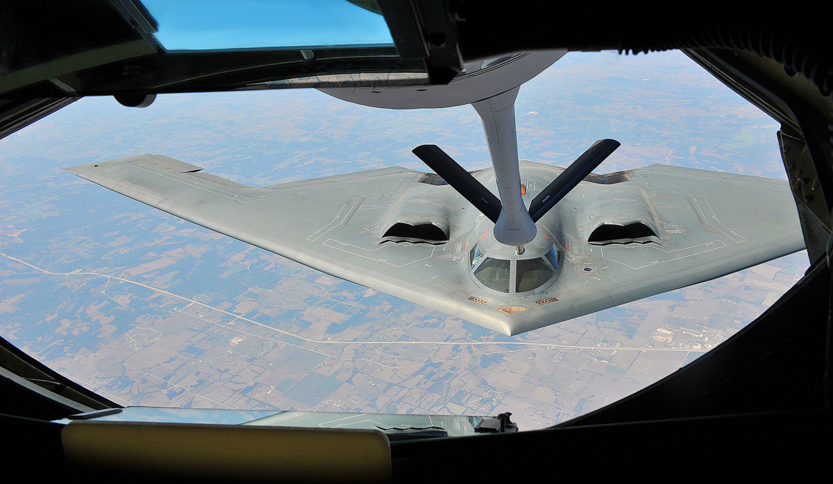A KC-135 Stratotanker aircraft with the 22nd Air Refueling Wing refuels a B-2 Spirit aircraft with the 509th Bomb Wing over Kansas