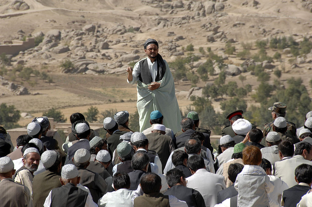 A mullah speaks to a crowd of villagers on the final day of Ramadan in the province of Day Kundi, Afghanistan. Wikimedia Commons/Creative Commons/ISAF