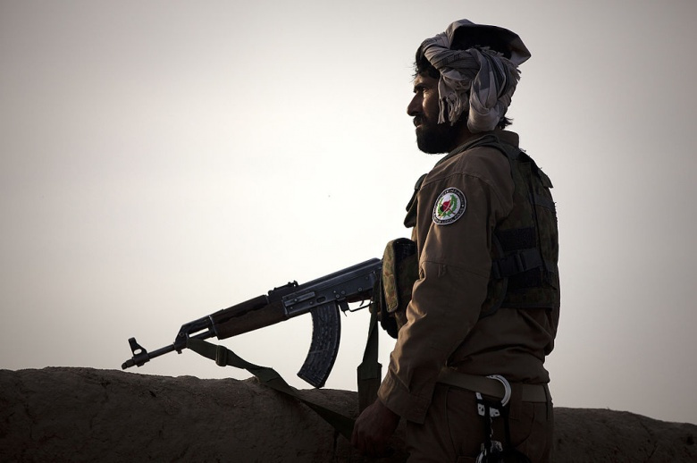 Afghan Local Policeman Abdul Salaam provides security along the edge of a compound in Loya Darvishan, Afghanistan. Wikimedia Commons/U.S. Marine Corps