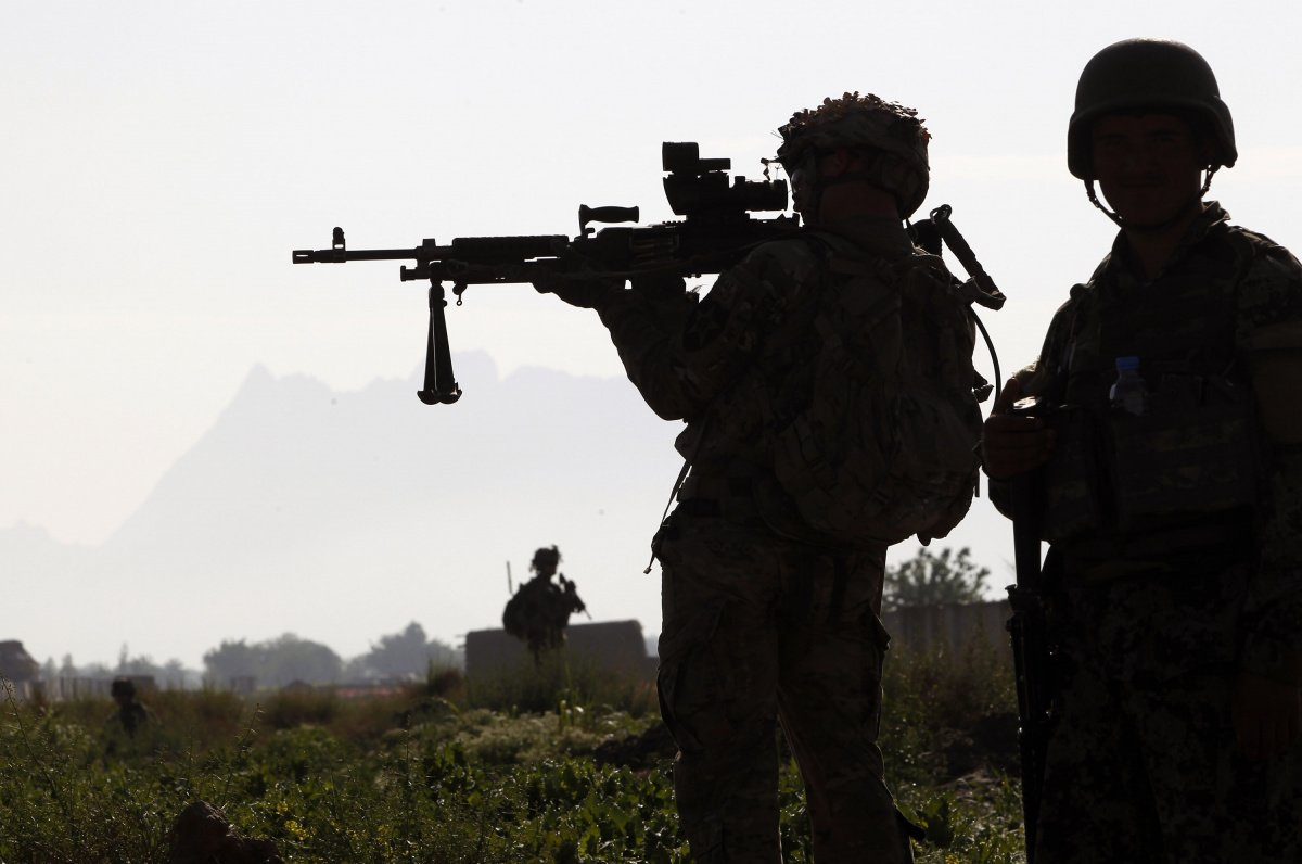 A U.S. soldier from 3rd platoon Bronco troop 5-20 infantry Regiment, attached to 82nd Airborne looks through his sights while on patrol with Afghan national Army soldiers in Zharay district, Kandahar province, southern Afghanistan