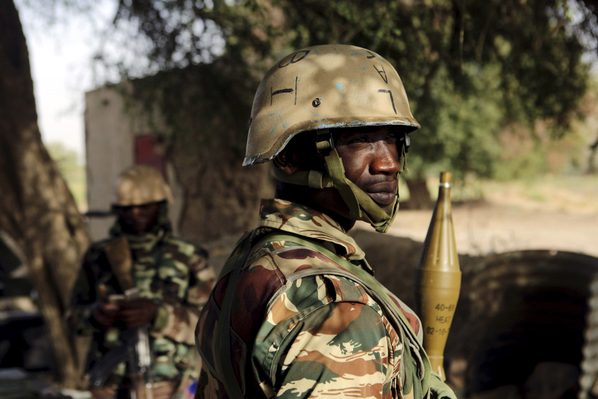 Nigerien soldiers stand guard at the border with Nigeria in Diffa, Niger