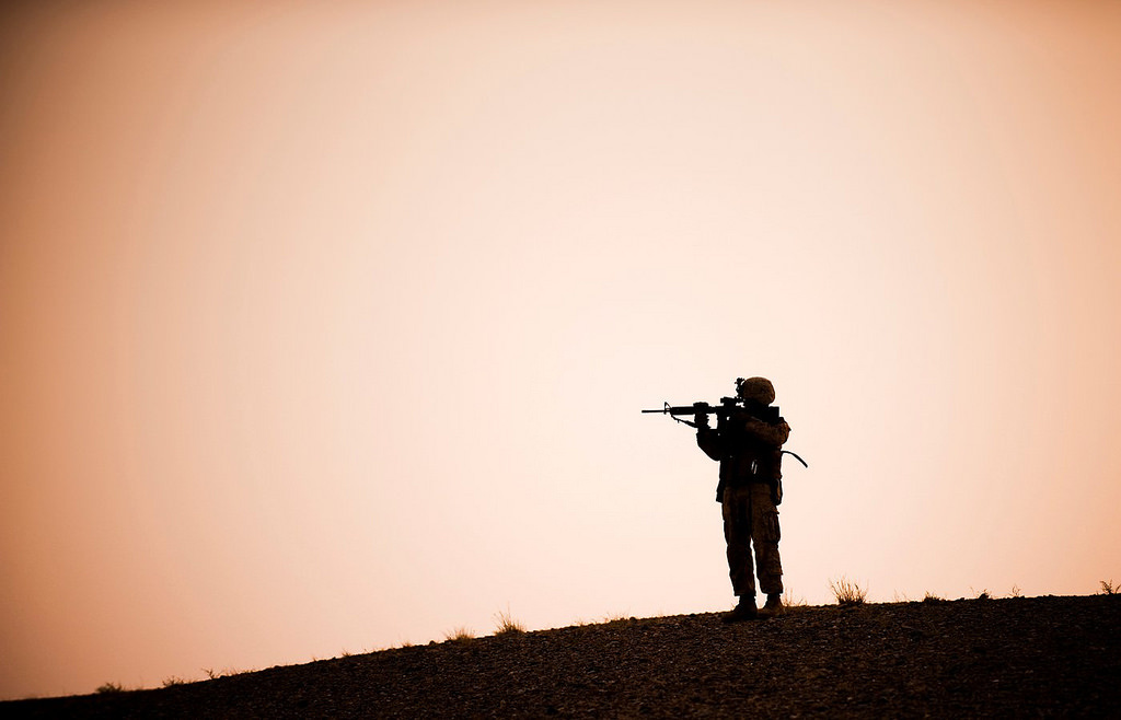 A Marine scans the horizon at the start of a nine-hour night patrol in the Helmand Province of Afghanistan. DVIDSHUB/Public domain