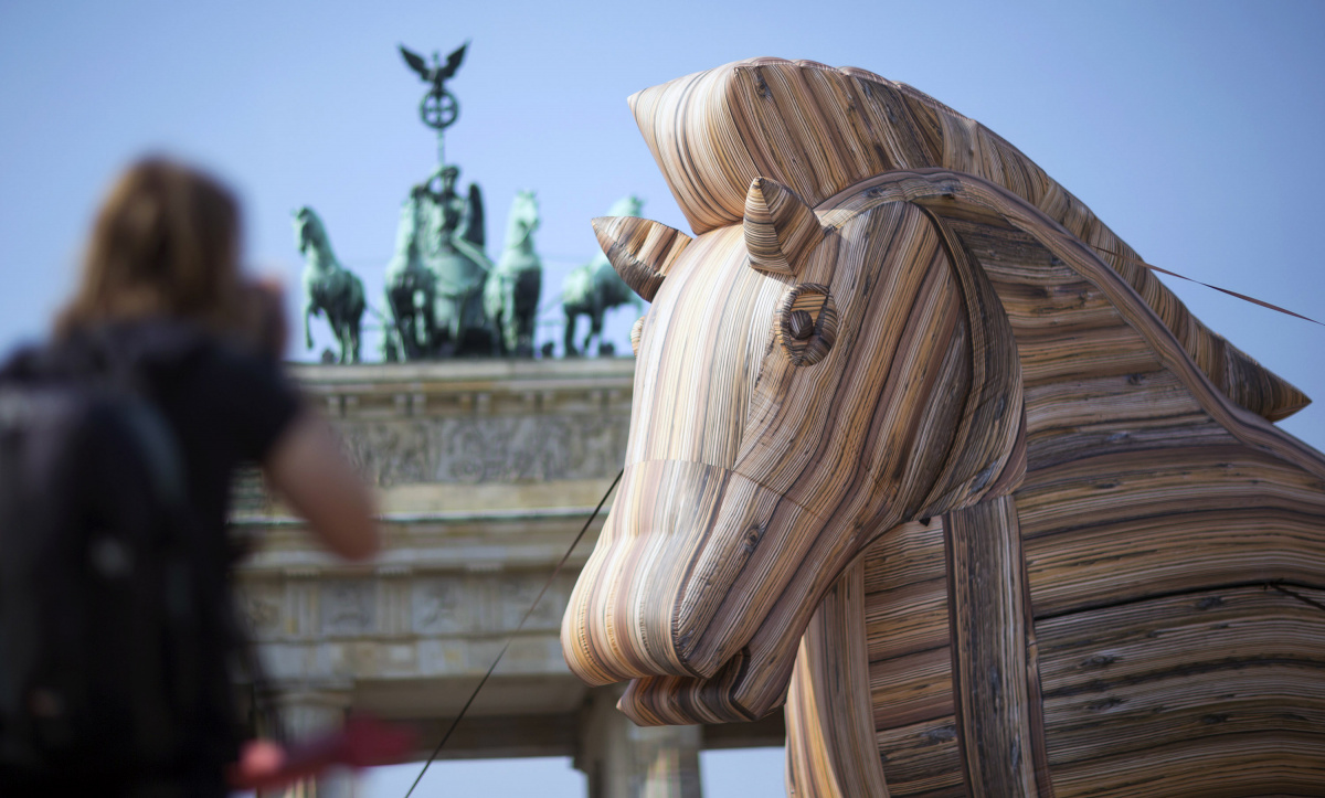 Environmental activists of BUND protest against the Transatlantic Trade and Investment Partnership with an eight metre high inflatable Trojan Horse, in front of Brandenburg Gate in Berlin