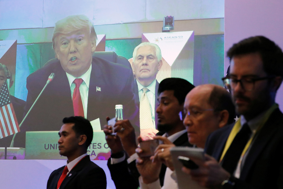 U.S. President Donald Trump is seen speaking on a screen during the U.S.-ASEAN Summit in Manila, Philippines