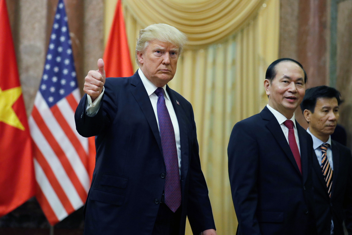 U.S. President Donald Trump gives a thumbs up next to Vietnam's President Tran Dai Quang upon his arrival at the Presidential Palace in Hanoi, Vietnam
