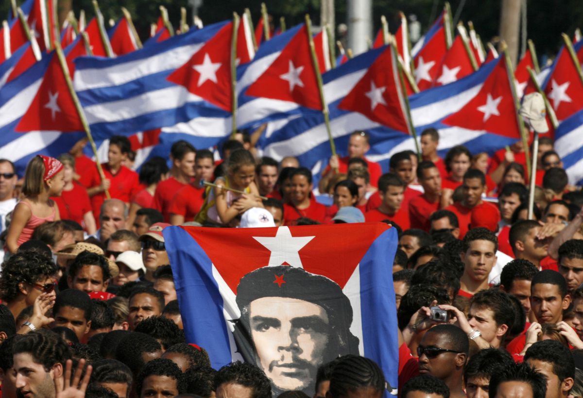 Image: Cubans march during the May Day parade on Revolution Square in Havana, May 1, 2007. Reuters/Claudia Daut