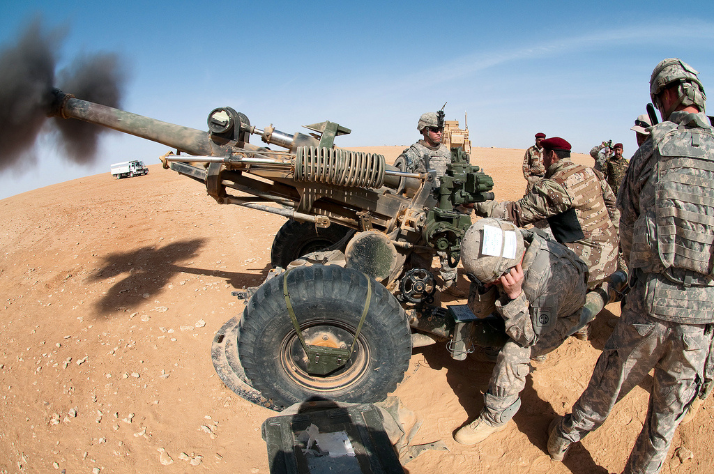 U.S. and Iraqi artillerymen fire 105-millimeter howitzers during live-fire training. Flickr/U.S. Army