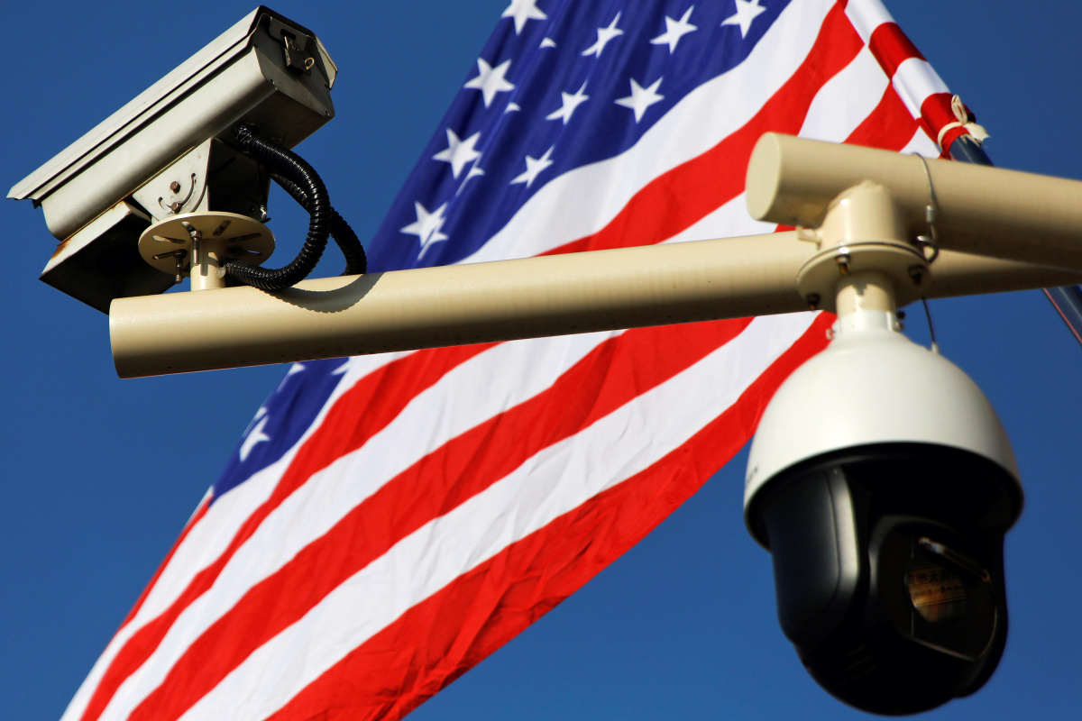 Security cameras are seen in front of a U.S. flag placed near the Forbidden City ahead of the visit by U.S. President Donald Trump to Beijing, China