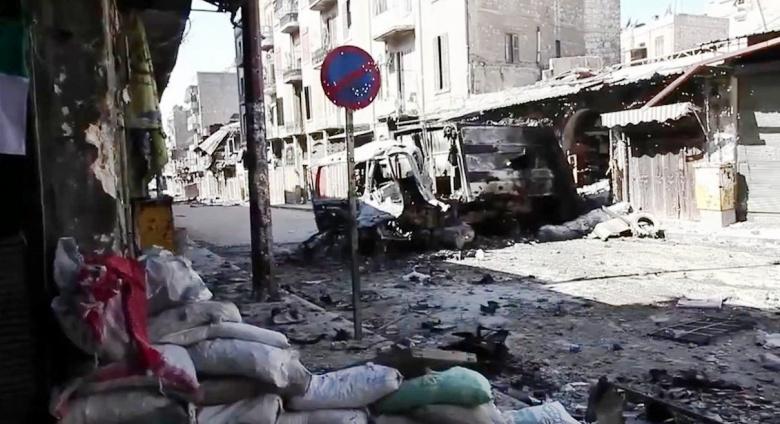 Image: Bombed-out vehicles in Aleppo, Syria, 2012. Photo via VOA/Scott Bobb.