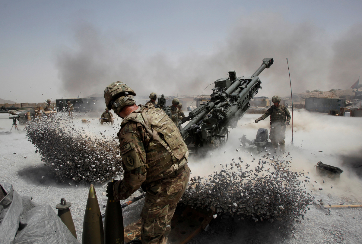 U.S. Army soldiers from the 2nd Platoon, B battery 2-8 field artillery, fire a howitzer artillery piece at Seprwan Ghar forward fire base in Panjwai district, Kandahar province southern Afghanistan