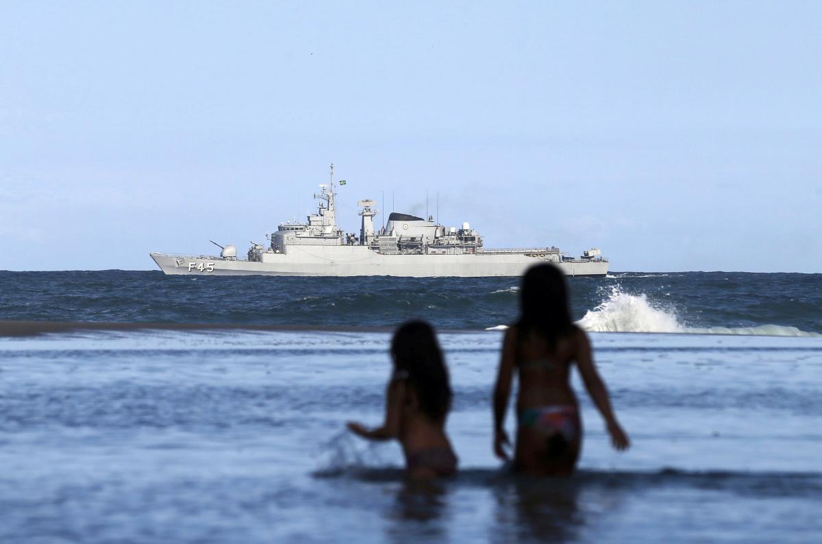Brazilian navy ship patrols offshore Ipanema Beach