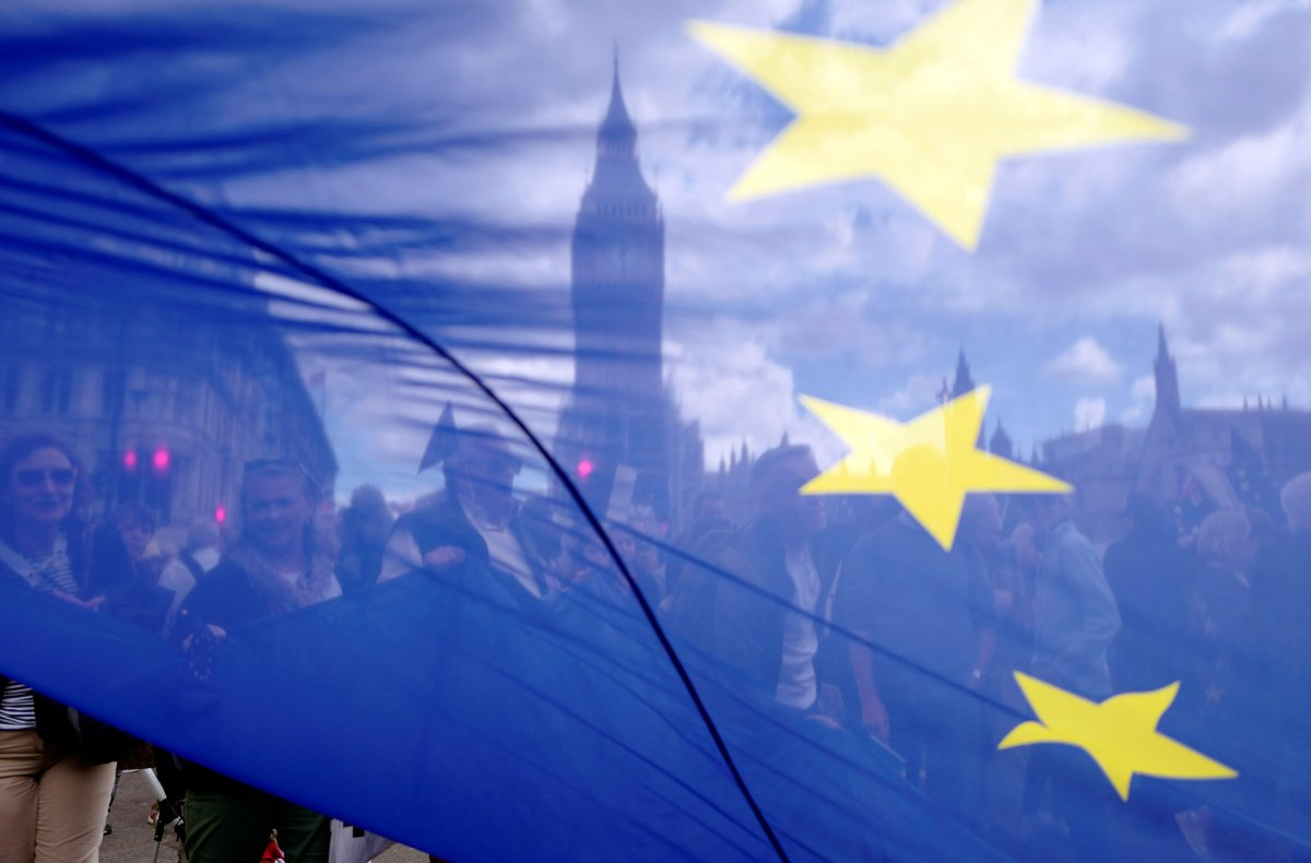 The Houses of Parliament are seen through a European Union flag as demonstrators arrive in Parliament Square during the anti-Brexit 'People's March for Europe', in central London, Britain