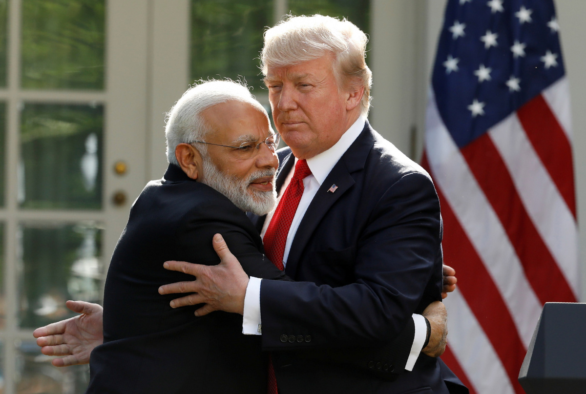 India's Prime Minister Narendra Modi hugs U.S. President Donald Trump as they give joint statements in the Rose Garden of the White House