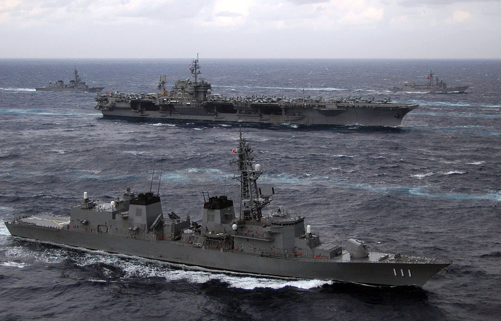 The Japan Maritime Self-Defense Force destroyer JDS Ōnami sails in formation with other JMSDF ships and ships assigned to the USS Kitty Hawk Carrier Strike Group. Wikimedia Commons/U.S. Navy