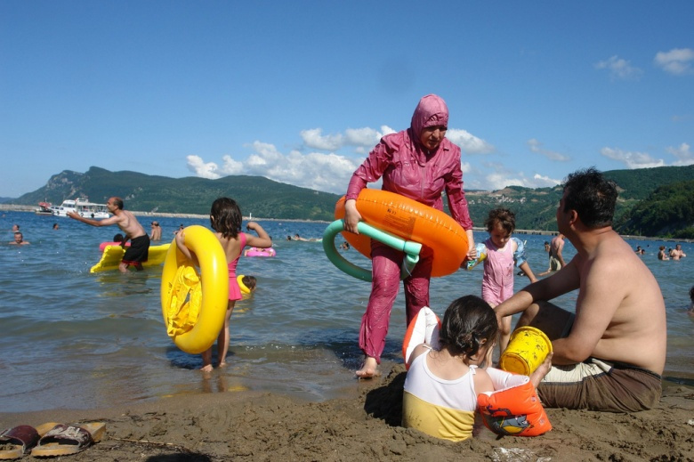 A bather wearing conservative Muslim dress in Turkey. Flickr/Charles Roffey