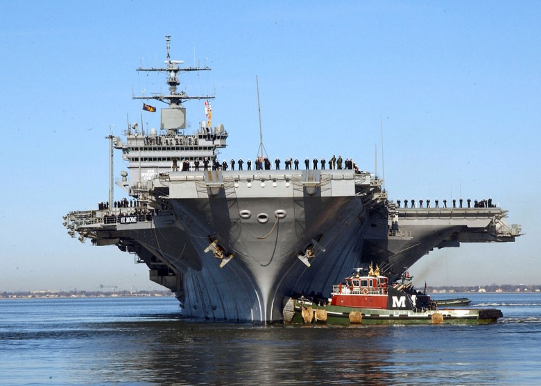 USS Enterprise approaches its pier at Naval Station Norfolk, Virginia. Wikimedia Commons/U.S. Navy