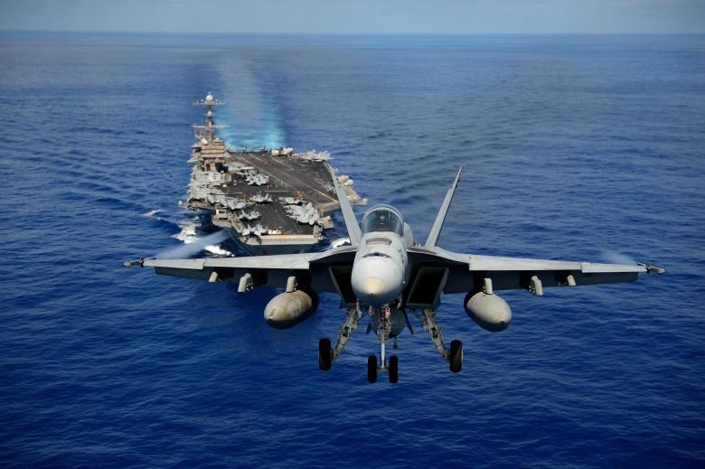An F/A-18E Super Hornet participates in an air power demonstration over the aircraft carrier USS John C. Stennis. Flickr/U.S. Navy