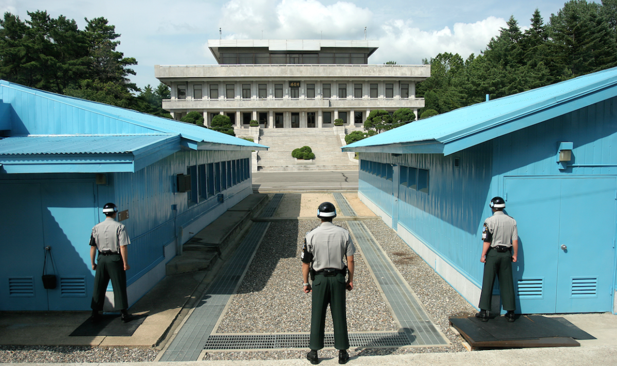 Three North Korean soldiers in the Demilitarized Zone. Wikimedia Commons/Creative Commons/Henrik Ishihara