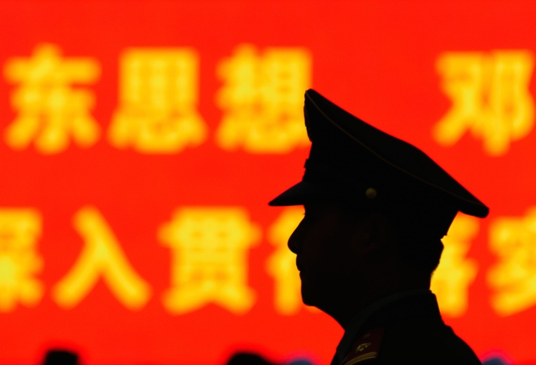 Guard in Tiananmen Square. Flickr/Johnathan Nightingale