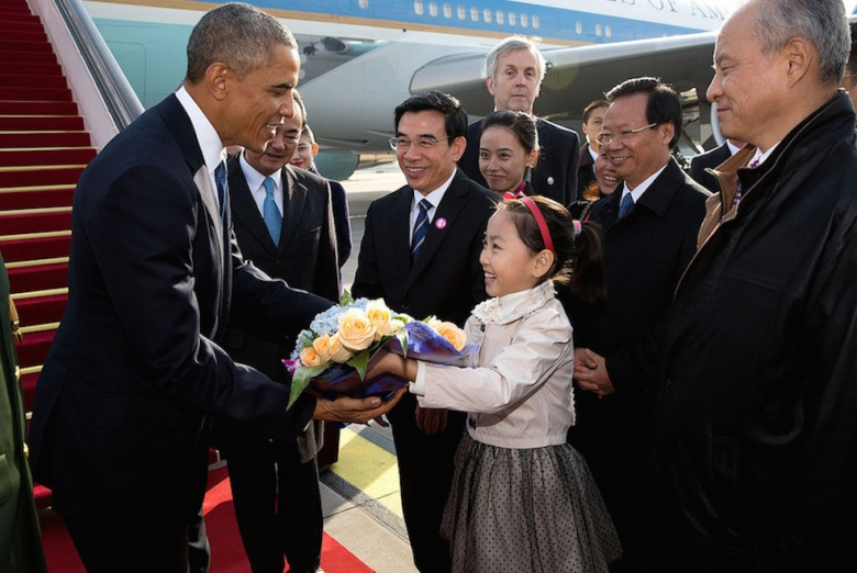 President Barack Obama is presented with a bouquet of flowers upon his arrival at Beijing Capital International Airport. Flickr/The White House