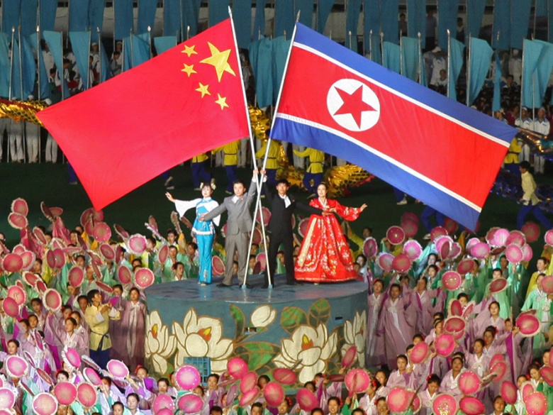 DPRK and Chinese flags at the Arirang Games. Flickr/Creative Commons/Roman Harak.