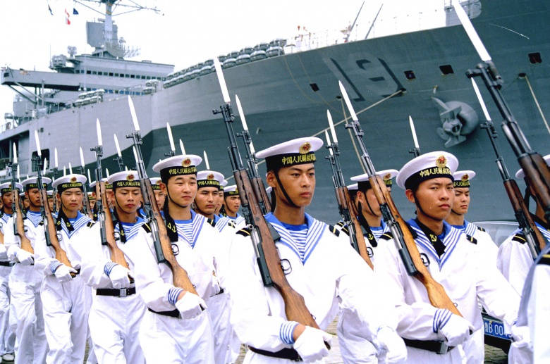 Image: Chinese sailors in front of an American ship. US Navy photo, public domain.
