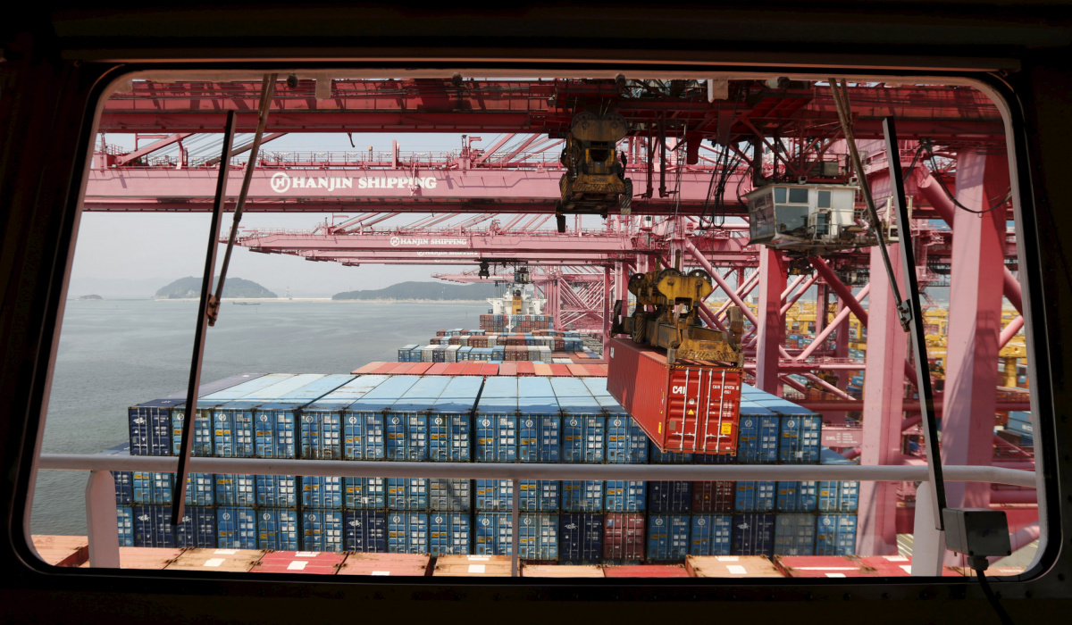 A crane carries a container from a ship of Hanjin Shipping at Hanjin container terminal at the Busan New Port in Busan