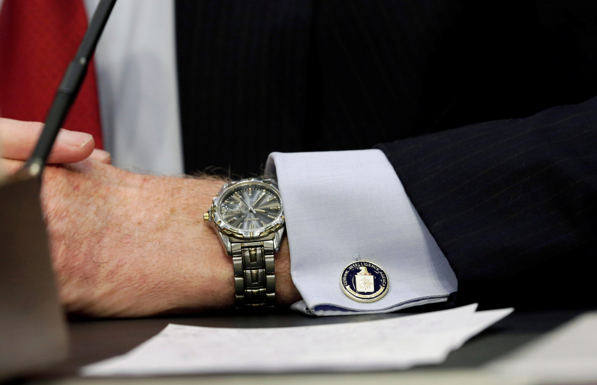 """An cufflink with CIA logo is seen on CIA Director John Brennan's shirt as he testifies before the Senate Intelligence Committee hearing on """"diverse mission requirements in support of our National Security"""", in Washington"""