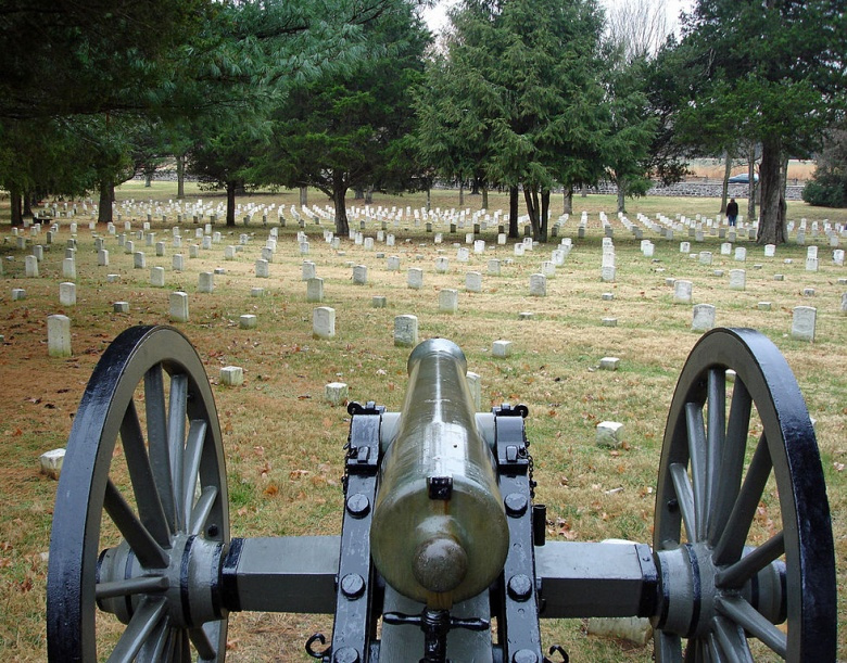 View of Stones River National Cemetery over the barrel of an M1857 Napoleon 12-pounder smoothbore. Wikimedia Commons/Hal Jespersen
