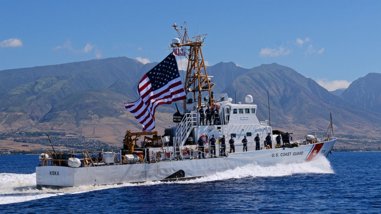 The crew of USCGC Kiska fly a battle ensign upon completion of a patrol. Flickr/U.S. Coast Guard