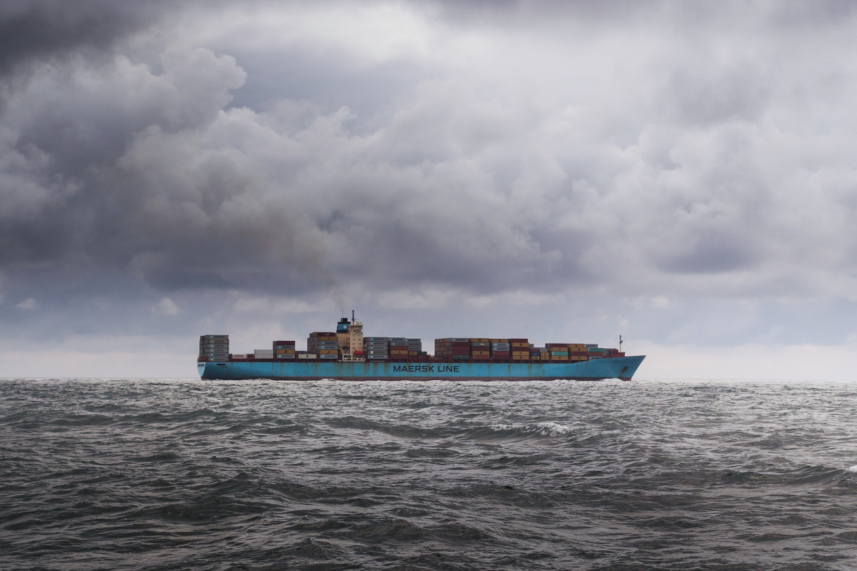 A cargo ship sails across the ocean.