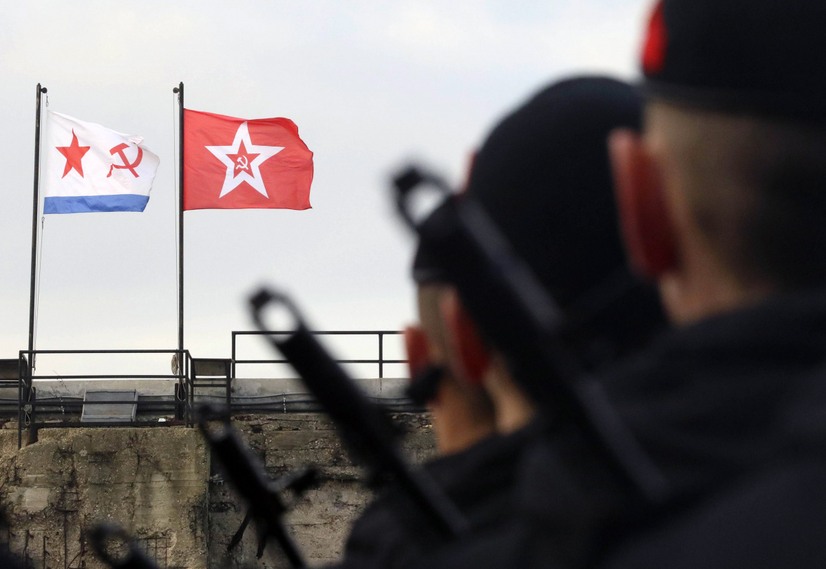 Russian Marine Corps conscripts stand in formation in front of Soviet Navy flags as they take the oath in the Black Sea port of Sevastopol