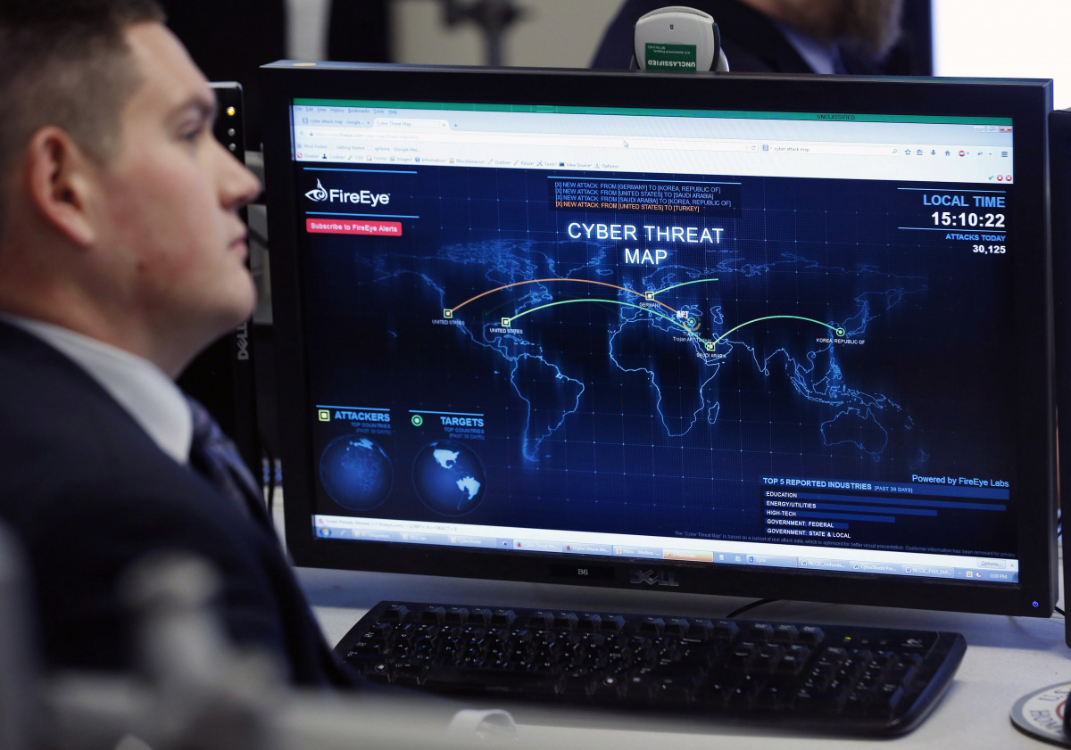 A Department of Homeland Security worker listens to U.S. President Barack Obama talk at the National Cybersecurity and Communications Integration Center in Arlington, Virginia