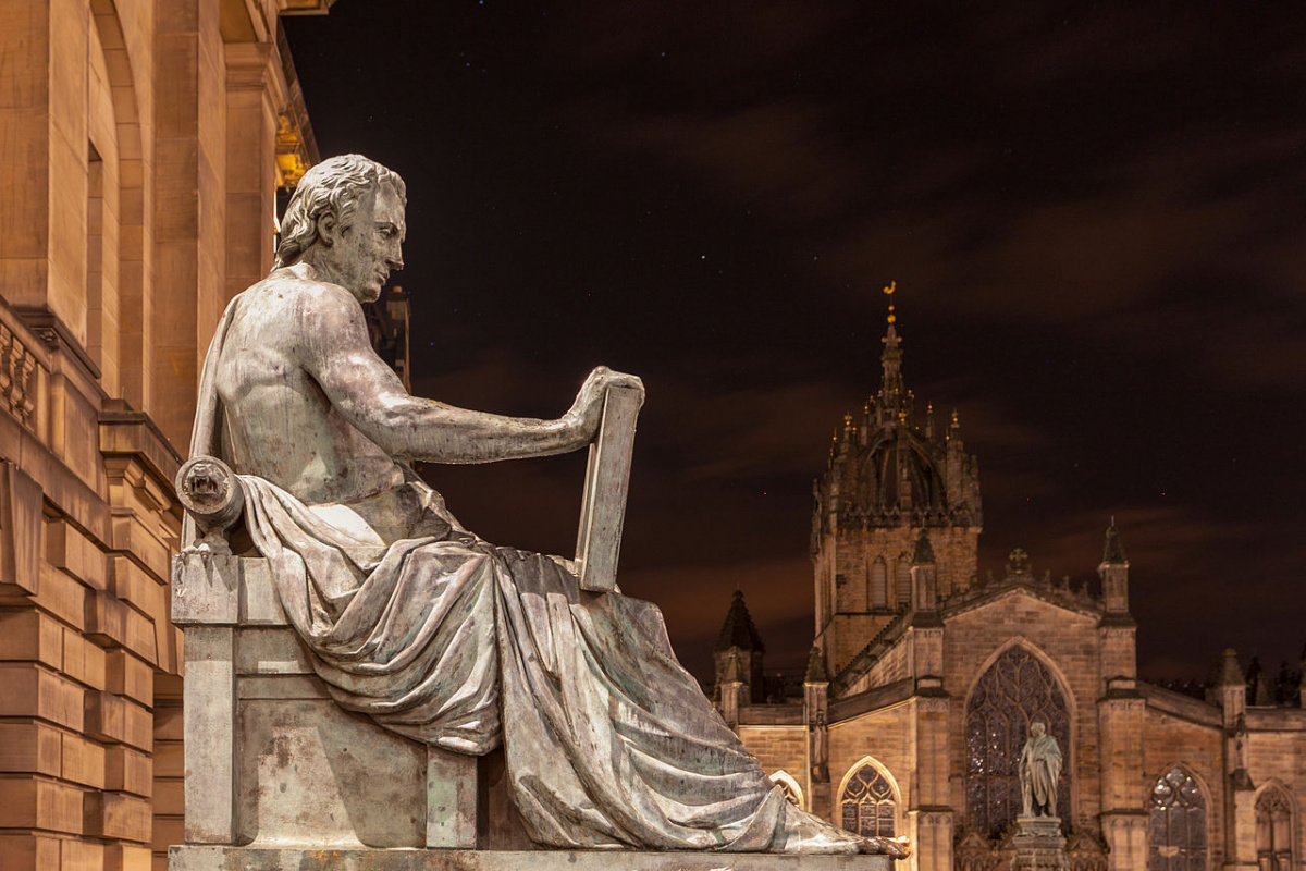 Statue of Scottish Philosopher David Hume (1711 to 1776) by Alexander Stoddart at one of the prominent landmarks on the Royal Mile in Edinburgh, Scotland.