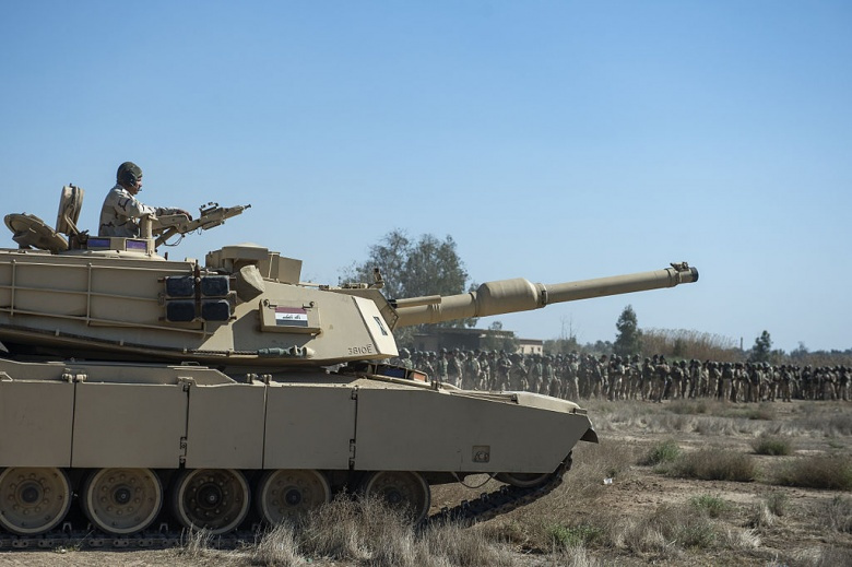 An Iraqi M1 Abrams battle tank gets into position during tactical training with Iraqi infantry soldiers at Camp Taji, Iraq. Wikimedia Commons/U.S. Air Force