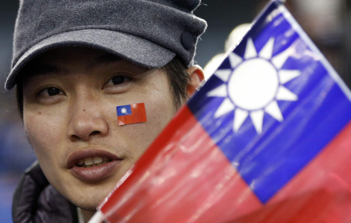A man poses with Taiwan's flag