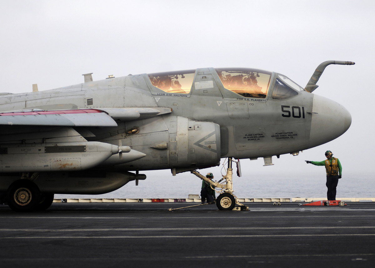 A U.S. Navy EA-6B Prowler aircraft prepares to launch from the aircraft carrier USS Abraham Lincoln. Flickr/Department of Defense