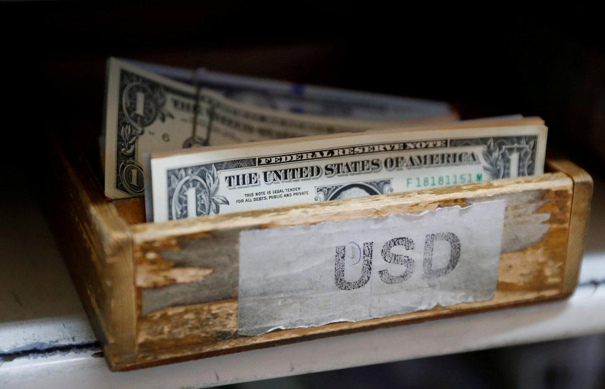 U.S. Dollar banknotes are seen in a box at the Money Service Austria company's headquarters in Vienna