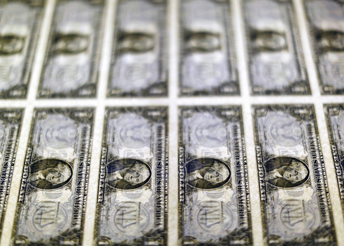 United States one dollar bills are seen on a light table at the Bureau of Engraving and Printing in Washington