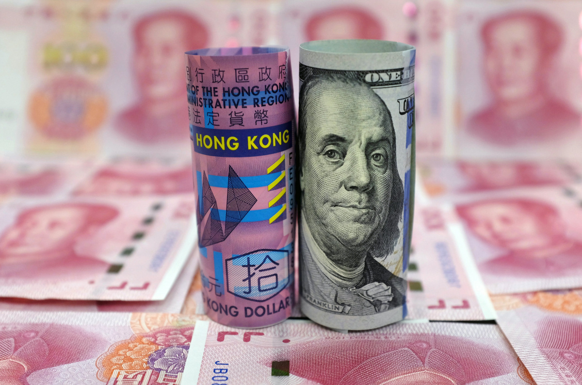 A Hong Kong 10 dollar banknote, a U.S. 100 dollar banknote, and Chinese 100 Yuan banknotes are seen in this picture illustration, in Beijing, China