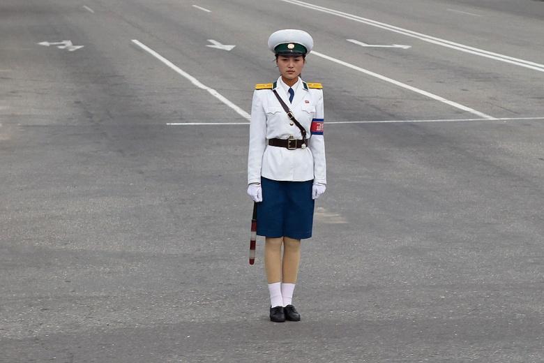 Traffic policewoman in Pyongyang. Wikimedia Commons/Roman Harak