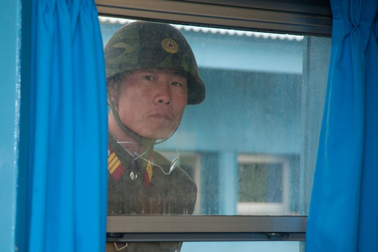 A North Korean soldier looks into the Joint Security Area near Panmunjom. Wikimedia Commons/U.S. Army