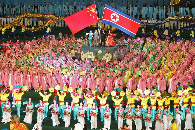 Chinese and North Korean flags at the Arirang Mass Games. Wikimedia Commons/Roman Harak