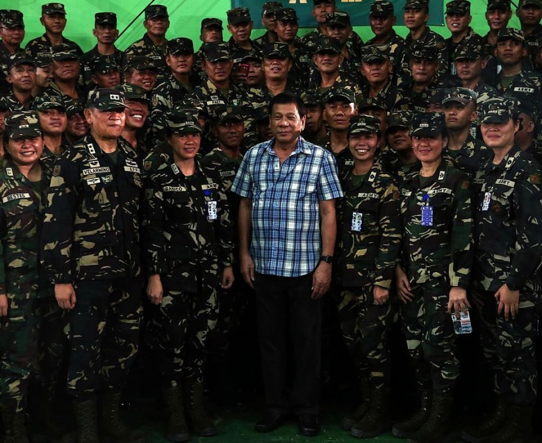 President Rodrigo R. Duterte poses with 8th Infantry Division troops. Wikimedia Commons/Presidential Communications Operations Office