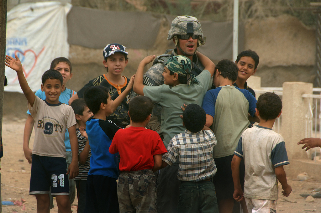 U.S. soldier on an aid mission in Baladiyat, eastern Baghdad. Flickr/DVIDSHUB
