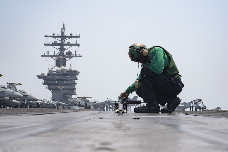 Aviation Boatswain's Mate (Equipment) Airman Malik Robinson conducts maintenance on a bow catapult on the flight deck of the aircraft carrier USS Dwight D. Eisenhower (U.S. Navy photo by Mass Communication Specialist 3rd Class Nathan T. Beard)